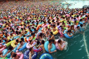 In this Sunday, Aug. 19, 2012 photo, people cool down in a swimming pool in Daying county, in southwestern China's Sichuan province. (AP Photo) CHINA OUT